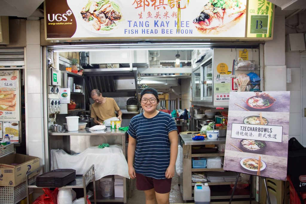 Hawker Debbie Yam standing in front of her stall Tang Kay Kee Fish Head Bee Hoon