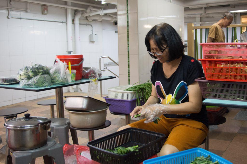 Ms Debbie Yam's aunty preparing the ingredients
