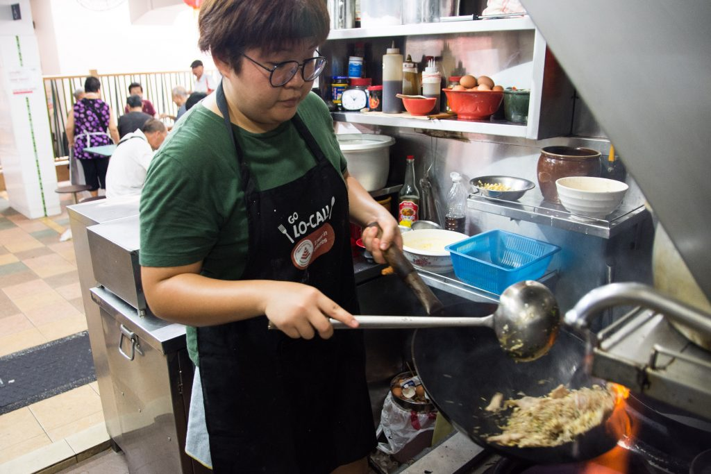 Ms Debbie Yam preparing food at the hawker stall