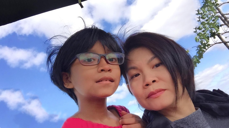 Mrs Samantha Chua and her daughter Izzy who has autism.