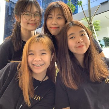 Leisure and Events Management student from Temasek Polytechnic Cynthia Ng with her fellow workers during an Earth Hour event at her workplace.