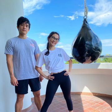 Abel Koh and Nerissa Assudani, the founders of Box Office Fitness, posing on a patio