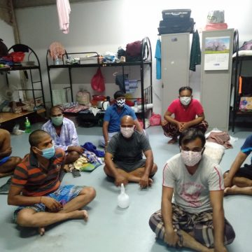 A photo of the migrant workers at Tekong Polder wearing the masks that Mr Bernard Ng had sewn for them
